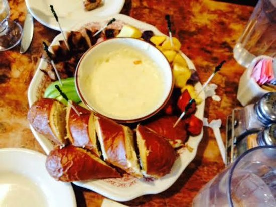 Belgian Waffle Works: Swiss cheese fondue with potatoes sausage apple and pretzel bread
