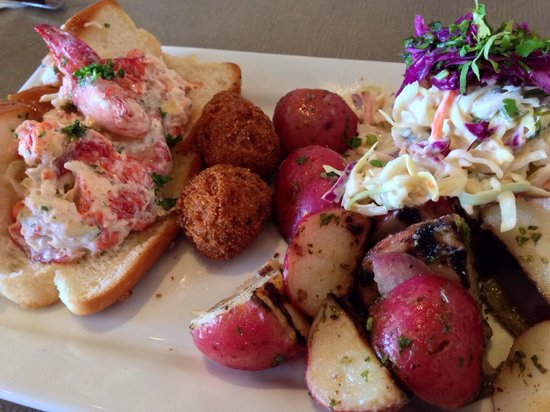 Sea Breeze Fish Market & Grill: Lobster roll with grilled potato salad and homemade cole slaw.