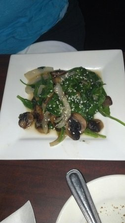 Izzy's Bistro: Spinach sauté with mushrooms, onions, capers in sesame seed oil