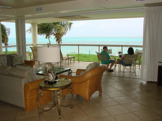 Coral Gardens on Grace Bay: On cool days you turn off AC and can retract the 6 sliding glass doors into thew wall