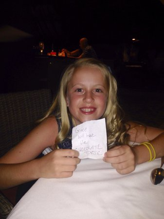 ZoZo's Ristorante: Server guessed what she wanted for dessert. He left a note under our candle. That's what she pic