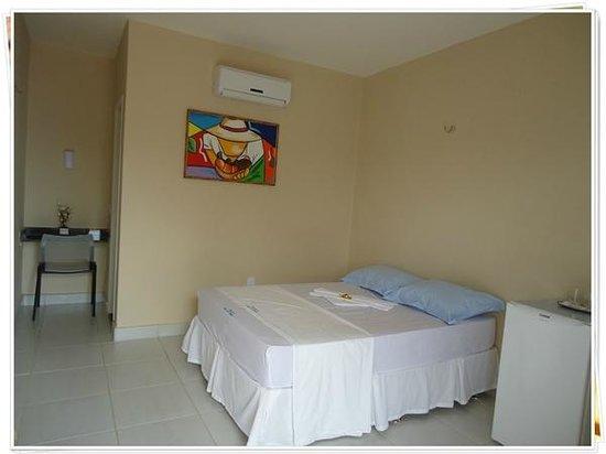 Pousada Lirios Do Campo: Foto de apartamento configurado para casal
