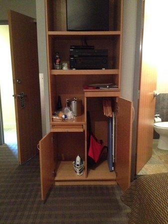 Charlesmark Hotel : small custom shelve/cabinets for iron, stereo, fridge, pull out shelve, cabinet