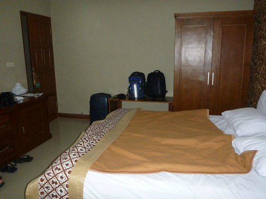 Pan Family Hotel: view from window - door in left hand corner, drawers, cupboards and tv left of pic also