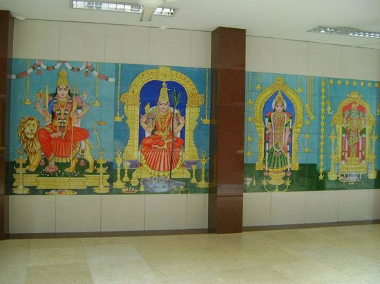 Sri Maha Mariamman Temple: Colourful images of the Gods on the corridor walls