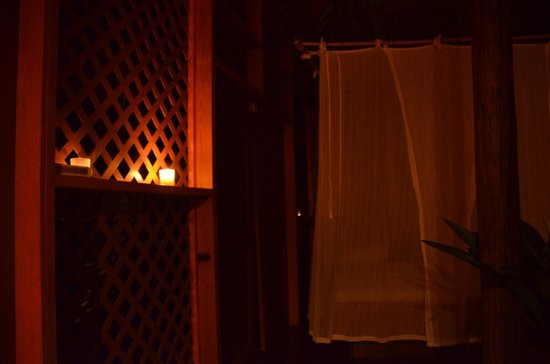 Manicou River: Candlelit room by night