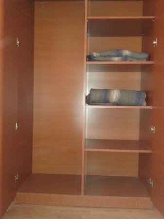 Hotel Zenix: No hopes to hang your cloths. This is all you get. The closet, DOT
