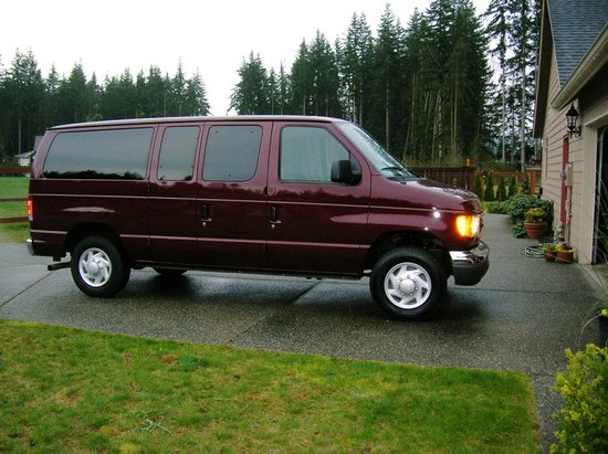 The Fischer House: The Cabernet Cab, wine tour vehicle, tinted windows.