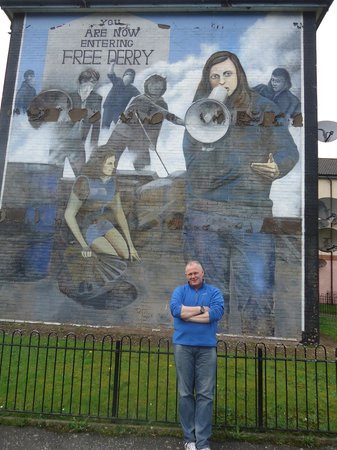 Museum of Free Derry: Guide Adrian, with mural in background