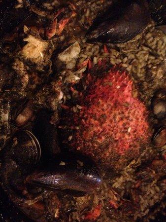 es grec: Arroz caldoso de cabra de mar.