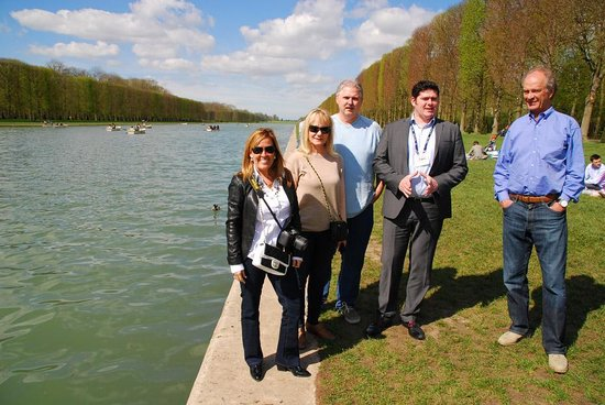 Private Tours Paris: Our happy group with our guide Stephane (in suit) at the Palace of Versailles on April 5, 2014