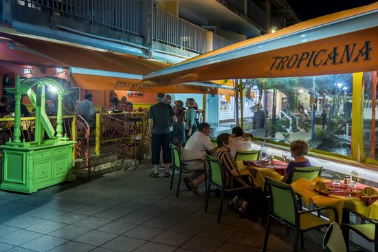 Tropicana: Tables by the water