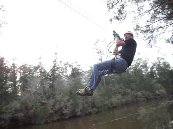 Adventures Unlimited Outdoor Center: Zip lining over the river.