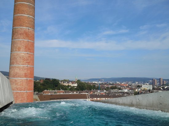 B2 Boutique Hotel + Spa: Pool on the roof, you can see the chimney of  the old beer brewery.