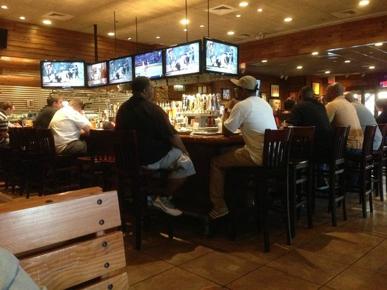 Smokey Bones BBQ & Grill: The large sports bar area in Smokey Bones