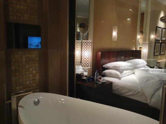 The Ritz-Carlton, Dubai : Window (with blind) between bathroom and bedroom
