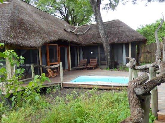 Wilderness Safaris Kings Pool Camp : Outside,  looking toward tent