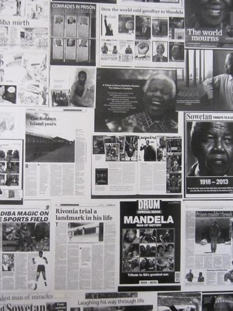 Pumbas Backpackers : The collage of Mandela outside our foor