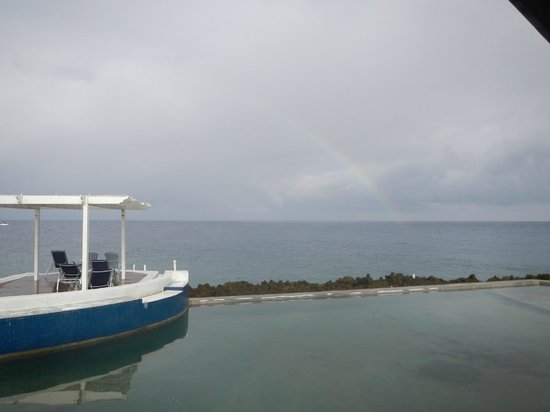 Lands End - Ocean Front Lodge: Rainbow over the pool.