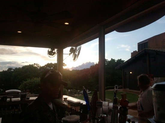 Lodge of  Four Seasons: Sun set at the pool bar with the best Rasta bar tender ever Chris!