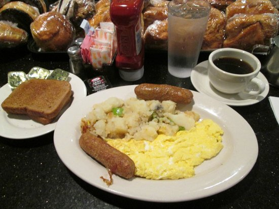 Scotty's Diner : Breakfast: Wheat toast with scrambled eggs, potatoes, turkey sausage, and coffee.
