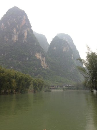 Yangshuo Mountain Retreat: View of hotel at base of mountain - taken from rafting trip