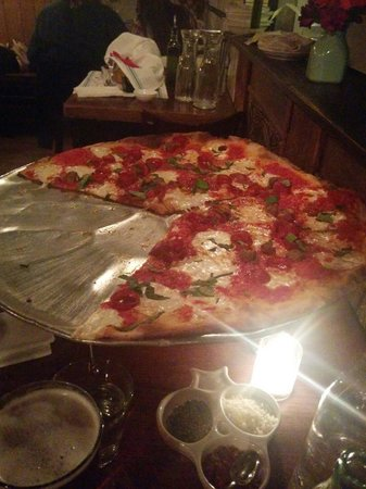 Rubirosa : It's not like the real Italian pizza...but the taste is f@#*ing delicious!!!