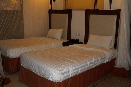 Ol Tukai Lodge: Sleeping area with mosquito nets