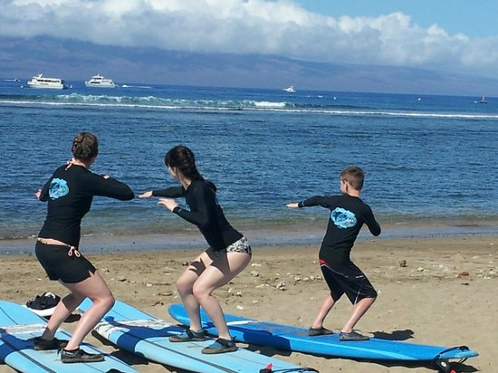 Goofy Foot Surf School, Inc : A lesson on the basics on the beach to begin with.