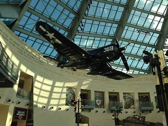 National Museum of the Marine Corps: A USMC Corsair fighter from WW2 hangs on display under the glass spire of the entry hall.