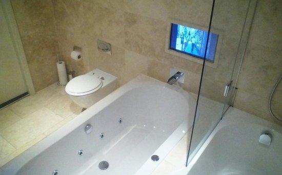 Signature Living: tv in bathroom ... woop woop