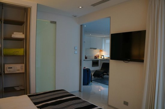 BYD Lofts Boutique Hotel & Serviced Apartments: View from bed towards the kitchen