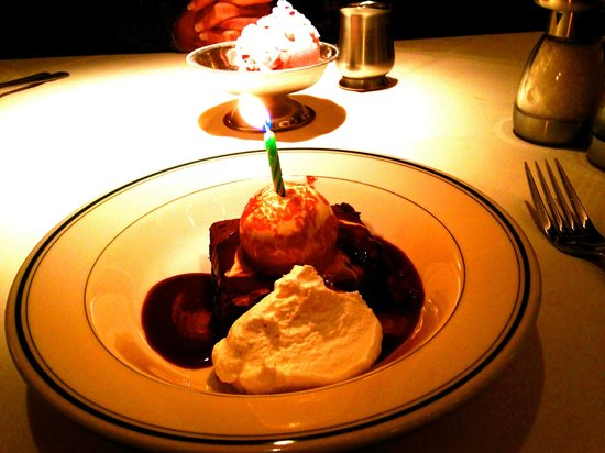 Joe's Seafood Prime Steak & Stone Crab: Birthday dessert: chocolate brownie topped with ice cream, fudge, & whipped cream & a candle