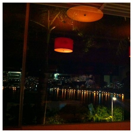 Tonys Asian Bistro: Looking out over the Bay from Tony's with the Chef in reflection