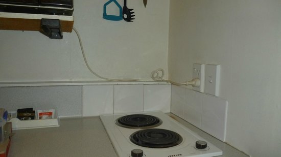 Apex on Fenton: dangerous cook top and power  cable running for microwave