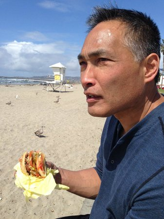 Hubby, Stan, contemplates the universe with a Hodad's bacon burger in hand.