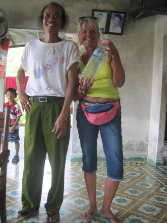 Hoian Cycling: Our lovely rice wine maker and wine!