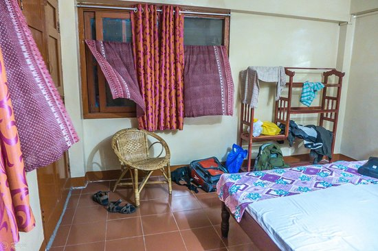 Noble Homestay, Andamans: Bedroom with wind blowing through curtains
