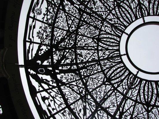 Sunken Gardens: Metal roof of the pergola is a work of art