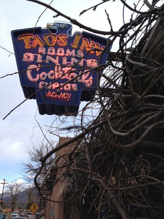 The Historic Taos Inn: Neon sign and vines