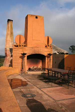 andBeyond Ngorongoro Crater Lodge: cocktails by the fireplace in the evening