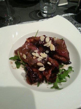 Osteria dei Pazzi : Antipasto pancetta all'aceto balsamico rucola e mandorle.