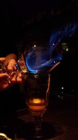 Restaurant 1833: Absinthe being warmed over flame