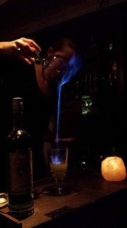 Restaurant 1833: Absinthe being poured into cocktail