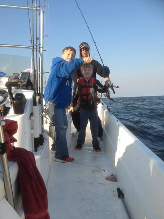 Reel Action Fishing Charters: Black Bass Fun for Boys