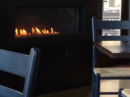 Babica Hen Cafe - Dundee: One of two fireplaces burning on a warm day.