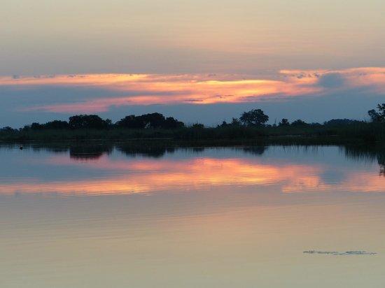 Shinde - Ker & Downey Botswana: Sunset on the delta