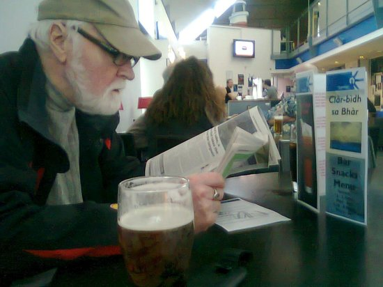 An Lanntair: [Cellphone Photo] My uncle & I [I'm behind the lens] out for a coffee & a beer, chat, browse mag
