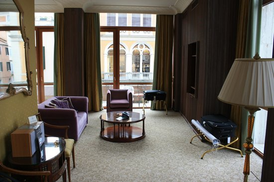 Bauer Hotel: Sitting Area and balcony's (bed is on the left behind the couch)
