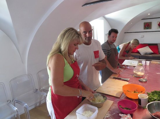 Fabiolous Cooking Day in Rome : Fabio and Mary discussing the food prep strategy.